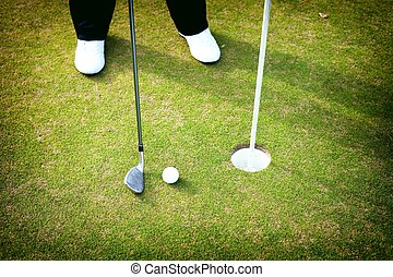 Playing Golf club and ball, Preparing to shot
