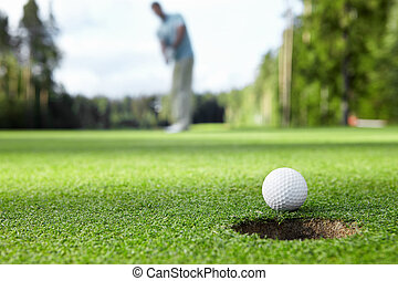 Playing golf - Golfer drove the ball into the hole