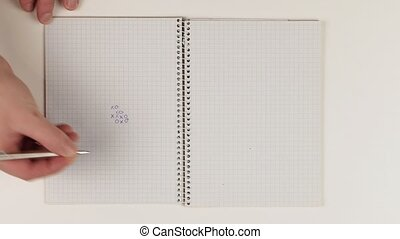 Playing gomoku five-in-a-row pen and paper version logic game, sped up timelapse