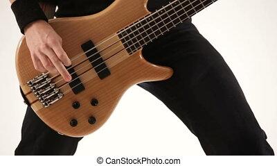 Playing guitar. Close-up