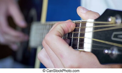 Playing Guitar - Man Playing Acoustic Guitar. Playing on...
