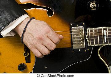 Playing guitar - playing guitar close-up