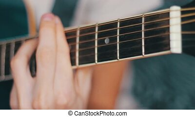 Playing guitar - Playing on acoustic guitar with over guitar...