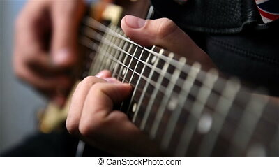 Playing Guitar Solo - Guitarist Playing Guitar Solo An...
