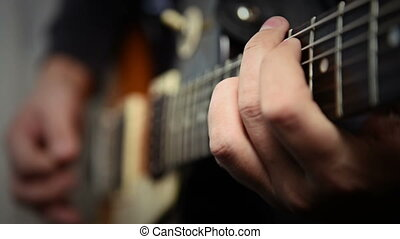 Playing Guitar Solo - Musician Plays Rock Music On...