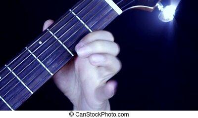 playing guitar, strum, disco rays lights.