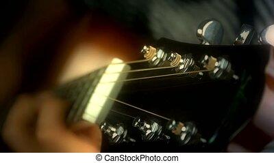 playing guitar, strum, doft warm lights.