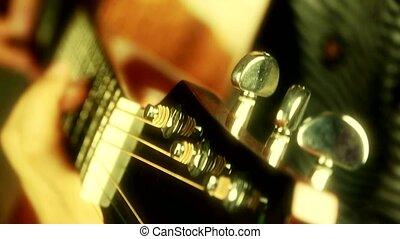 playing guitar, strum, golden sunlight.
