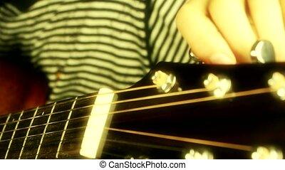 playing guitar, strum.