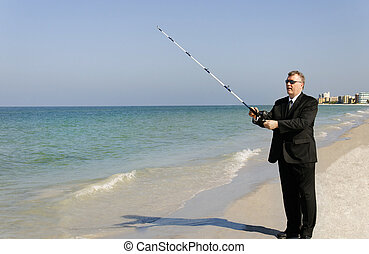 Playing Hooky - A man in a business suit fishing at the...