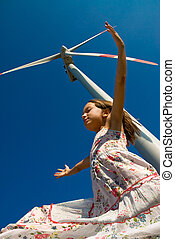 playing in the wind - girl playing in the wind under a...