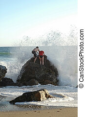 Playing in Waves - A couple play in the surf