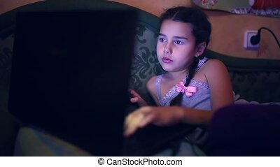 playing laptop teen girl lying on the sofa computer game internet search