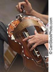 Playing old Britain instrument