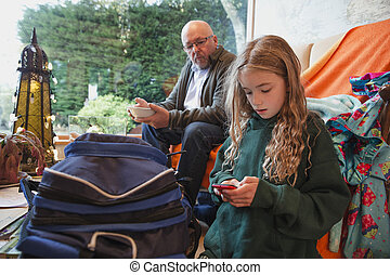 Playing on her Phone before School