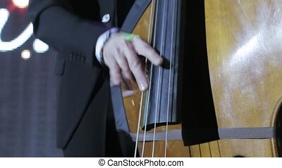 Playing on the double bass