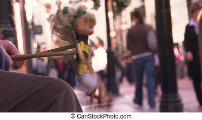 Playing puppet on a street - A steady shot of a puppet as a...
