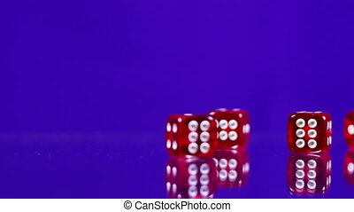 Playing red Casino Dice Cubes on a Glass Table. - Red dice...