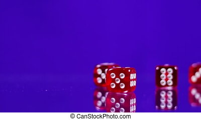 Playing red Casino Dice Cubes on a Glass Table.
