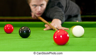 Playing snooker - Snooker player placing the cue ball for a...