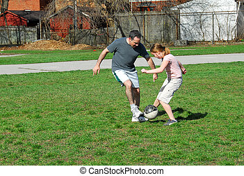Playing soccer - Family playing soccer