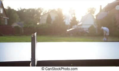 Playing table tennis game in slow motion outdoor close-up on sunny day. 3840x2160