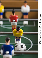 tabletop soccer - playing tabletop soccer with red and ...