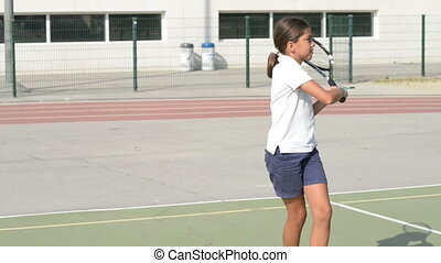 Playing Tennis - Beautiful girl playing tennis on tennis...