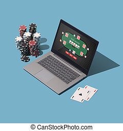 Playing Texas hold 'em poker online on a laptop, piles of ...