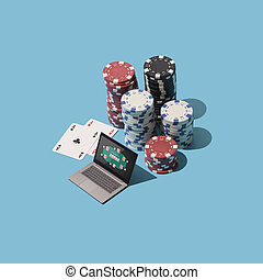 Playing Texas hold 'em poker online with laptop, piles of ...