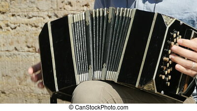 playing the bandoneon