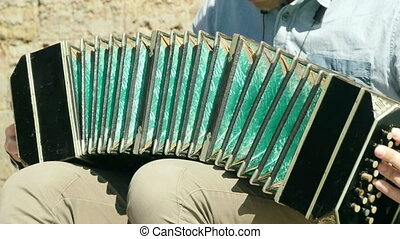playing the bandoneon slow motion - bandoneon musical...
