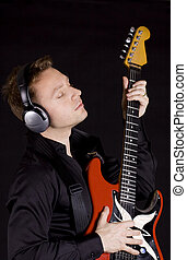 Playing the blues - Male mid aged guitarist playing his...