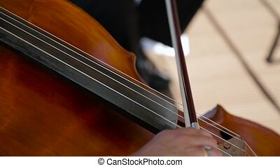 Playing the cello close up