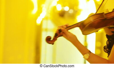 Playing the cello on banket - Female hand playing violin at...