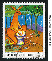 Playing the Drum - GUINEA CIRCA 1968: stamp printed by...
