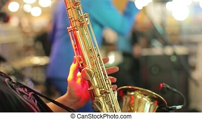 Playing the saxophone close up
