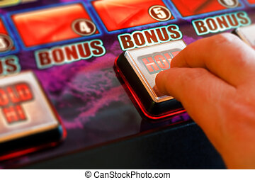 gambler playing a gaming machine at the amusement arcade