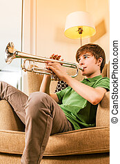 Playing the trumpet in the living room