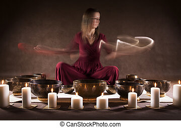 Playing Tibetan bowls