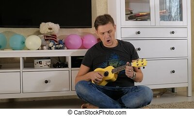 playing ukulele selective soft focus 4k
