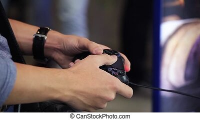 Playing video game with joystick - Playing games console...