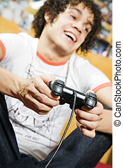 video games - playing video games: guy feet crossed on the...