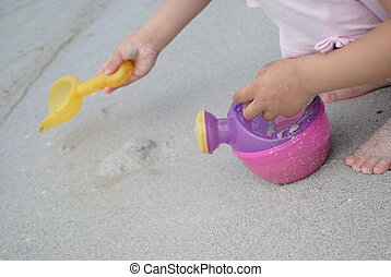 playing with beach toys