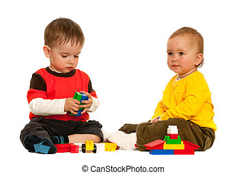 Playing with blocks two toddlers