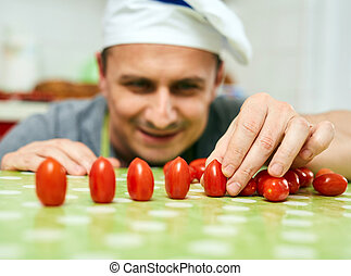 Playing with cherry tomatoes