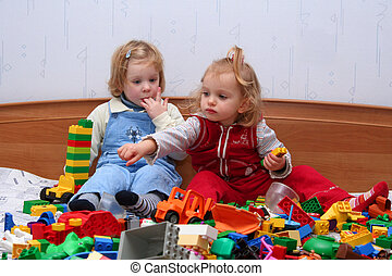 Playing with cube blocks - Two little girls playing with...