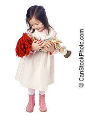 Playing with Dolly - A young asian girl playing with a doll