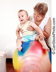 Playing with gymnastic ball - Small boy have a fun with the...