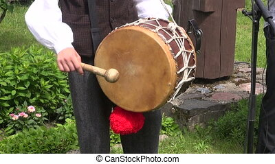 playing with old musical drum